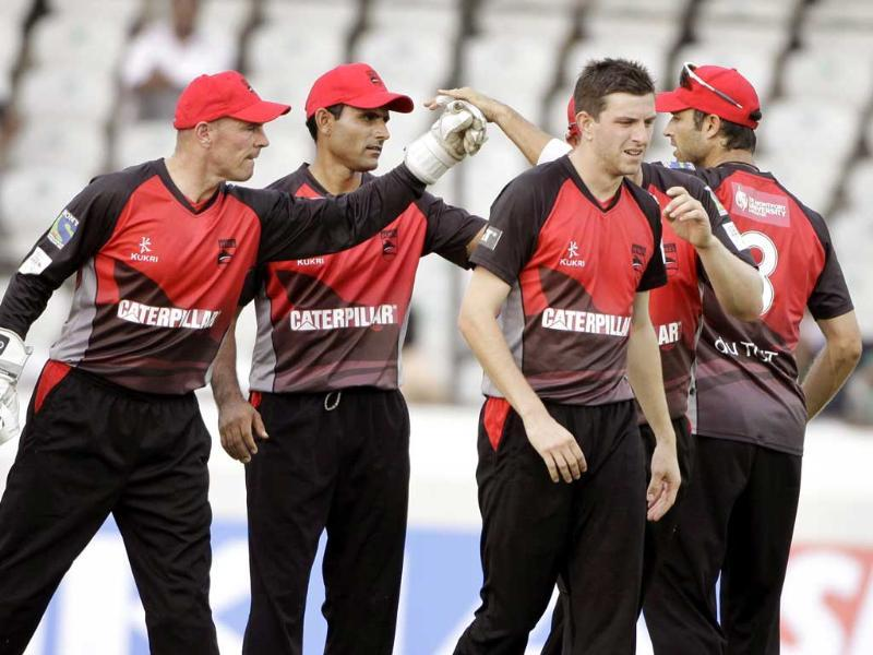 Leicestershire bowler Harry Gurney, celebrates with teammates the wicket of Trinidad and Tobago player Adrian Barath during the Champions League Twenty20 cricket qualifying match between Leicestershire and Trinidad Tobago in Hyderabad.