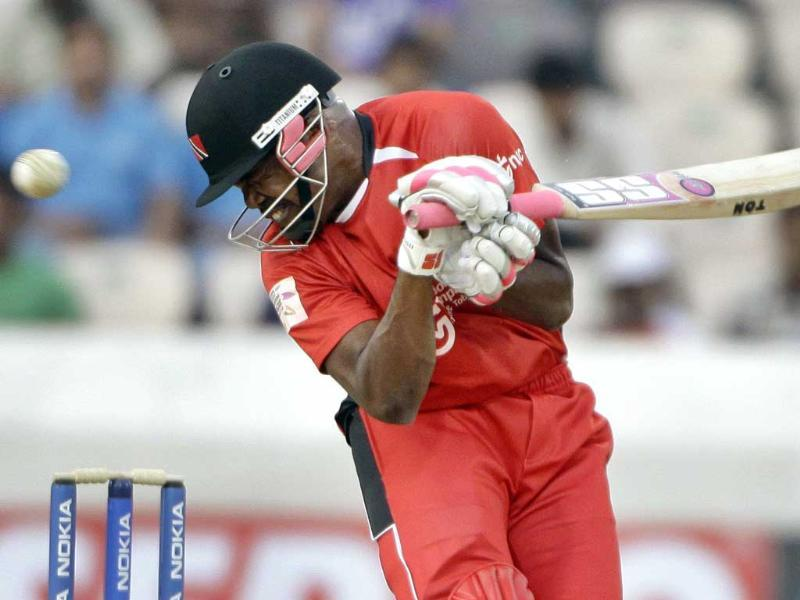 Trinidad and Tobago player Darren Bravo avoids a bouncer during the Champions League Twenty20 qualifying match between Leicestershire and Trinidad Tobago in Hyderabad.
