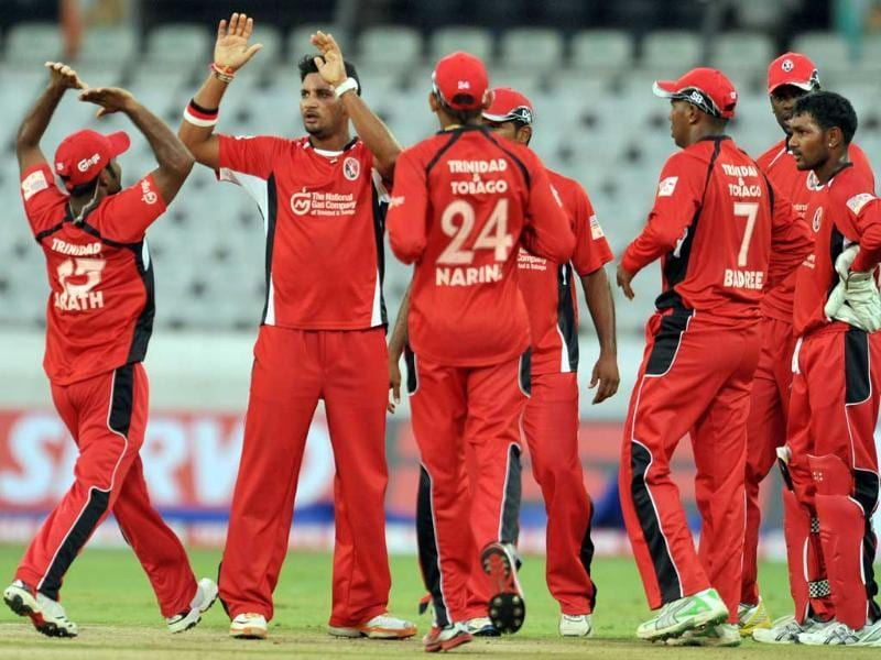 Trinidad and Tobago bowler Ravi Rampaul (2L) celebrates a wicket during the Champions League Twenty20 League qualifying pool cricket match between Trinidad and Tobago and Leicestershire Foxes at the Rajiv Gandhi International Stadium in Hyderabad.