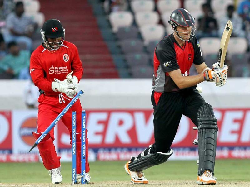 Leicestershire Foxes batsman Jefferson is bowled by Trinidad and Tobago bowler Badree during the Champions League T20 match between Trinidad and Tobago and Leicestershire Foxes at the Rajiv Gandhi International Cricket stadium in Hyderabad.