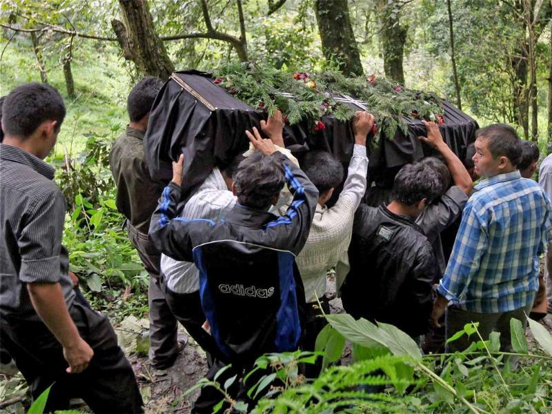 People carrying the body of one of the victims of Sunday's earthquake at Mangan, the worst affected hamlet in North Sikkim on Tuesday. The former kingdom, Sikkim, which became part of India in 1975, has no airports or railway stations and foreign tourists must obtain special permits before visiting.