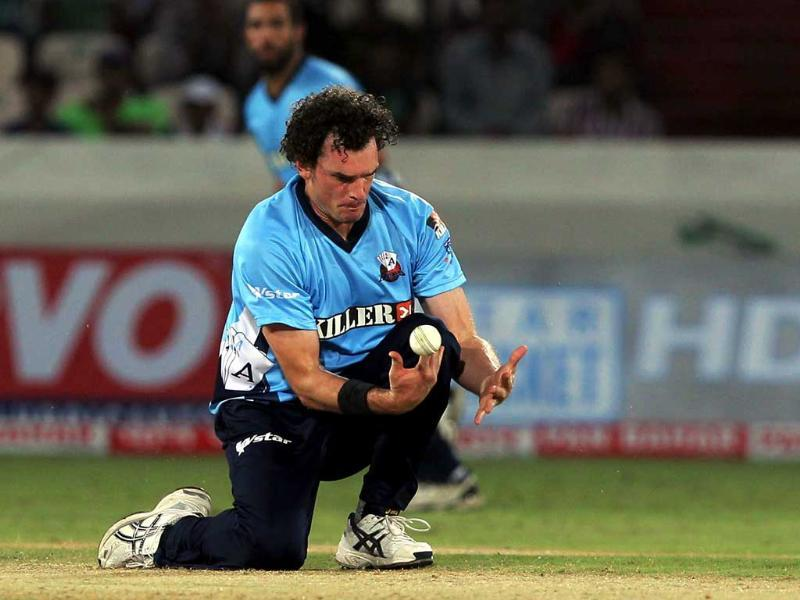 Auckland Aces bowler Kyle Mills drops Somerset batsman Van der Merve during the Champions League T20 match between Somerset and Auckland at the Rajiv Gandhi International Cricket stadium in Hyderabad.