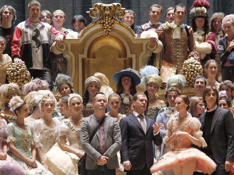 Russia's President Dmitry Medvedev (first row 5th R) talks to members of the company at the Bolshoi Theatre in Moscow.