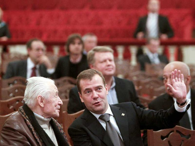 Russia's President Dmitry Medvedev (R) talks to famous choreographer Yury Grigorovich as he visits the Bolshoi Theatre.