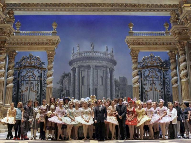 Russia's President Dmitry Medvedev (C) poses for a picture with members of the company at the Bolshoi Theatre.