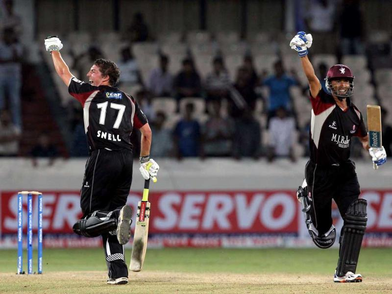 Somerset batsmen Snell and Thomas celebrate after the winning run on the last ball during the Champions League T20 match between Auckland Aces and Somerset at the Rajiv Gandhi International Cricket stadium in Hyderabad.
