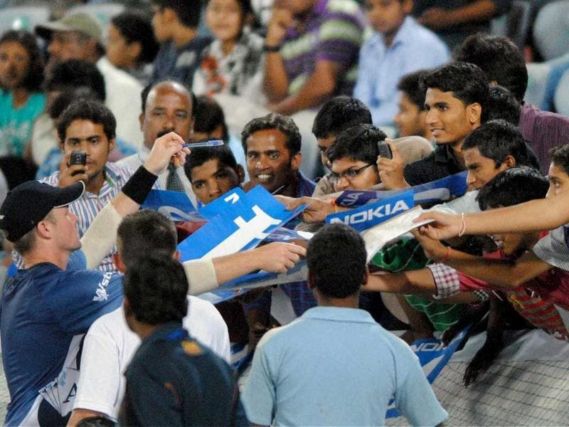 C Munro of Auckland Aces signs autographs for fans before the qualifying match against Somerset at the Champions League T20 tournament in Hyderabad.