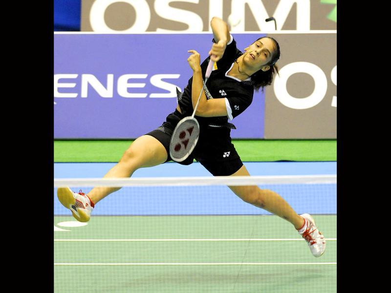 Saina Nehwal smashes the shuttlecock towards Inthanon Ratchaanok of Thailand during their women's singles first round match at the Japan Open badminton championships in Tokyo.