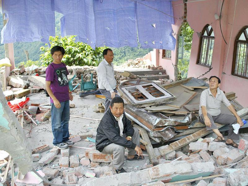 Villagers gather in the ruins of a church in Dikchu, some 20km from Mangan in Sikkim, after a 6.8 earthquake struck on Sunday.