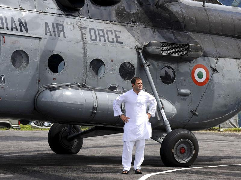 Congress general party Rahul Gandhi stands beside an Indian Air Force helicopter on the tarmac at Gangtok, as he arrives to survey the scene following a 6.8 magnitude earthquake in Sikkim.