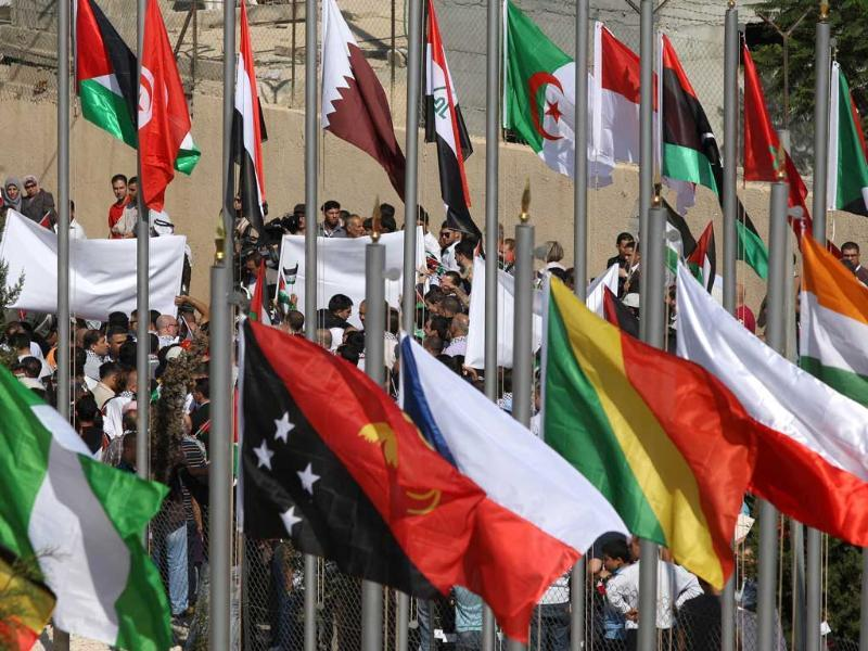 Flags of countries that recognize the Palestinian state flutter as thousands of Palestinians attend a demonstration in support the Palestinian bid for statehood recognition at the United Nations in the West Bank city of Ramallah.