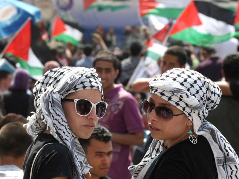 Thousands of Palestinians attend a demonstration in support the Palestinian bid for statehood recognition at the United Nations in the West Bank city of Ramallah.