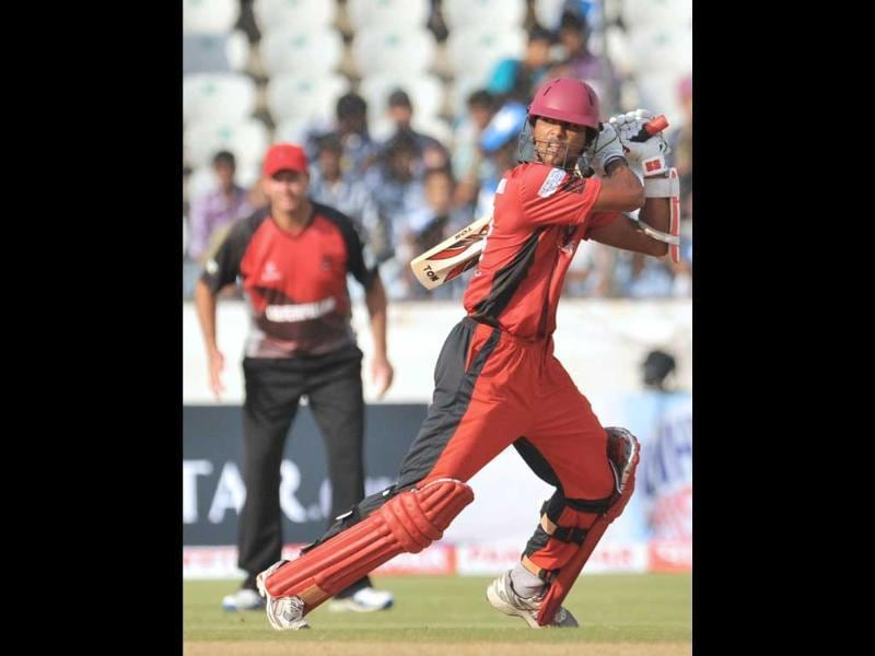 Ruhunu XI batsman Dinesh Chandimal plays a shot during the Champions LeagueTwenty20 League qualifying pool cricket match between Ruhunu XI and Leicestershire Foxes at The Rajiv Gandhi International Stadium in Hyderabad.