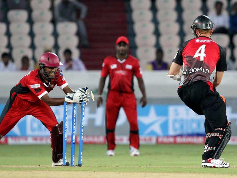 Leicestershire Foxes batsman McDonald is stumped by Ruhunu Eleven wicketkeeper Chandimal during the Champions League T20 match between Leicestershire Foxes and Ruhunu Eleven at Rajiv Gandhi International Cricket stadium at Hyderabad.