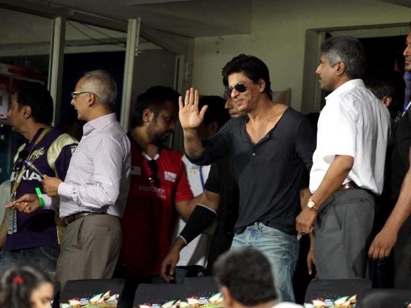 KKR owner Shahrukh Khan greets players on his arrival at the stadium during the Champions League T20 match between Kolkata Knight Riders and Somerset at Rajiv Gandhi International Cricket stadium at Hyderabad.