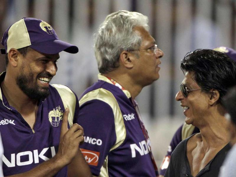 Bollywood actor and Kolkata Knight Riders team owner Shah Rukh Khan, right, gestures to Yusuf Pathan, left, during the Champions League Twenty20 qualifying cricket match between Kolkata Knight Riders and Somerset in Hyderabad.
