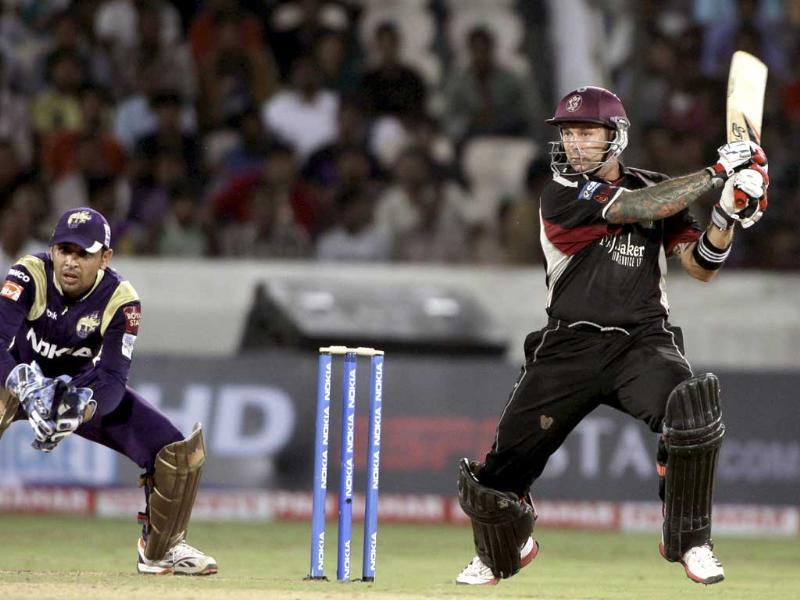 Somerset batsman Peter Trego plays a shot as Kolkata Knight Riders wicketkeeper Manvinder Bisla looks on during the Champions League Twenty20 qualifying cricket match between Kolkata Knight Riders and Somerset in Hyderabad.