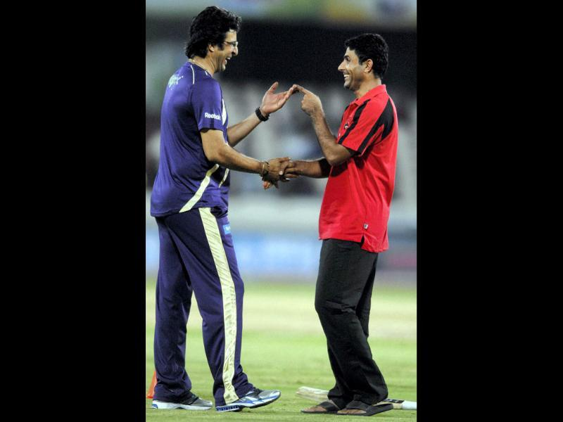 Wasim Akram and A Razzak share a light moment before the start of the match between, Somerset and Kolkata Knight Riders at Champions League Twenty20, Qualifying Tournament in in Hyderabad.