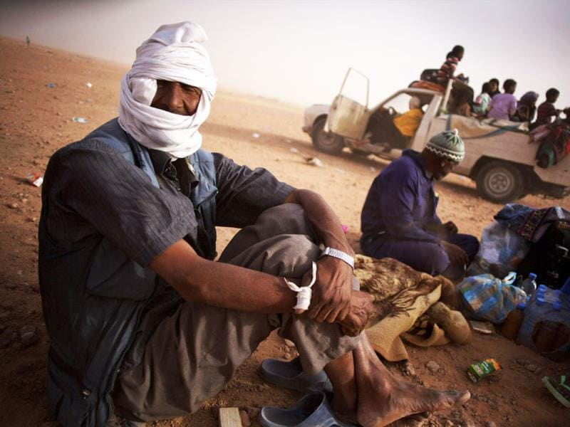 Niger Tuareg refugees rest after they fled Sirte and headed towards Misrata, Libya.