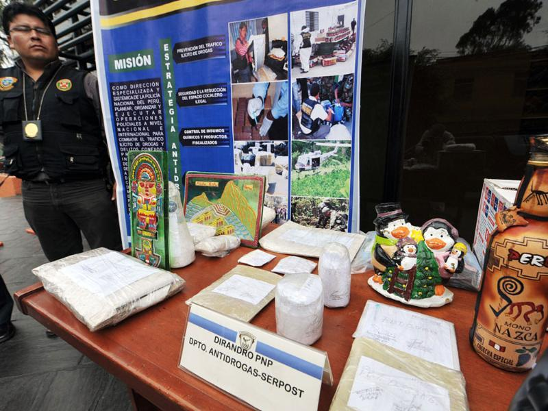A display about drug smuggling modalities during a presentation to the press by the Anti Drug Division of the Peruvian National Police in Lima following the capture of thirty-seven people and the seizure of more than a ton of cocaine and derivates and 39 tons of a variety of supplies for its elaboration.