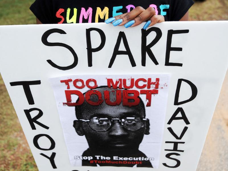 Brittany Stokes of McDonough holds a sign calling for Georgia state officials to halt the scheduled execution of convicted cop killer Troy Davis at the Georgia Diagnostic and Classification Prison in Jackson.