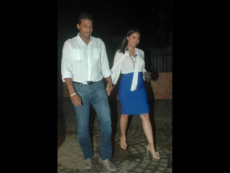 Lara Dutta looks stunning with her baby bump as she arrives with husband Mahesh Bhupati.