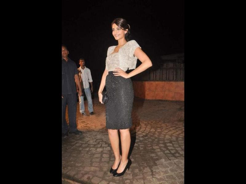 Sonam looks stunning in a knee-length black skirt worn with a shrug over a tube top.