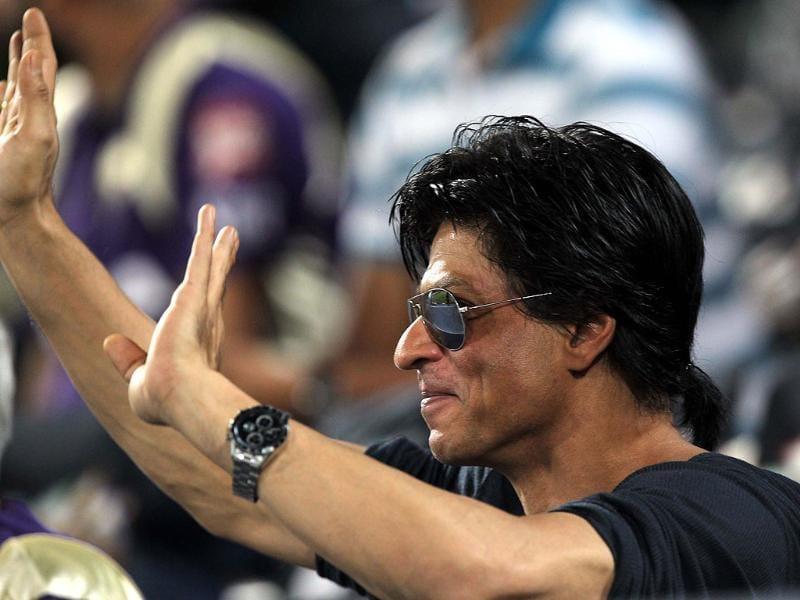 Shah Rukh waves to his fans from the pavillion.