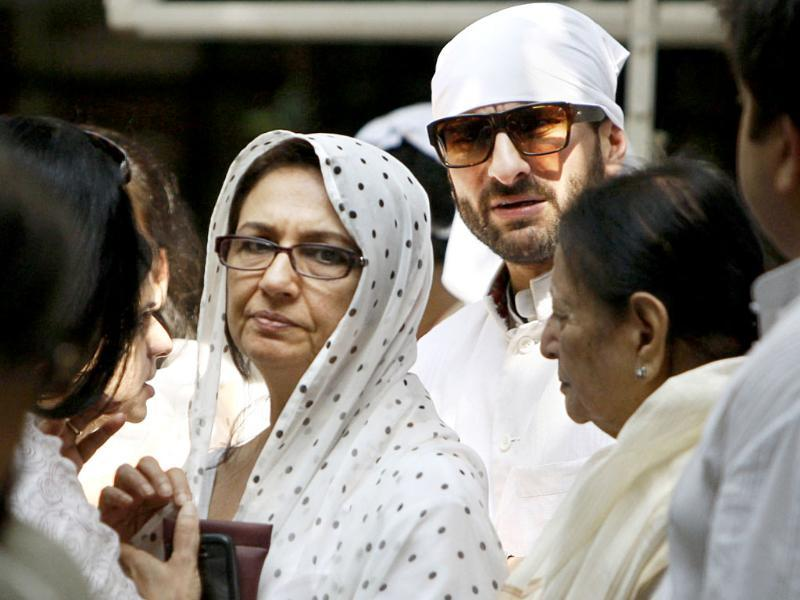 Sharmila Tagore and son Saif Ali Khan are seen during the funeral procession of Mansoor Ali Khan Pataudi in New Delhi.