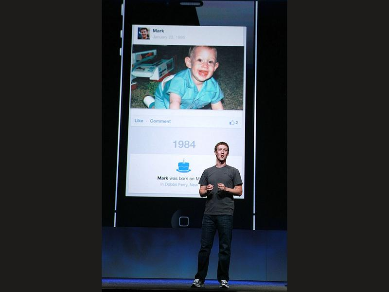 Facebook CEO Mark Zuckerberg shows a photo of himself as a baby as he delivers a keynote address during the Facebook f8 conference. Facebook CEO Mark Zuckerberg kicked off the conference introducing a Timeline feature to the popular social network.
