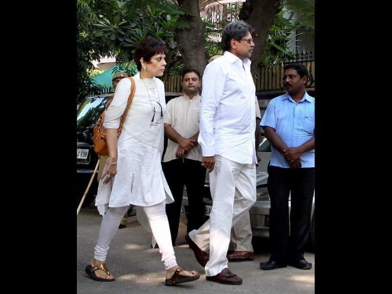 Former cricketer Kapil Dev and his wife arrive to offer their condolences to Mansoor Ali Khan Pataudi's family in New Delhi.