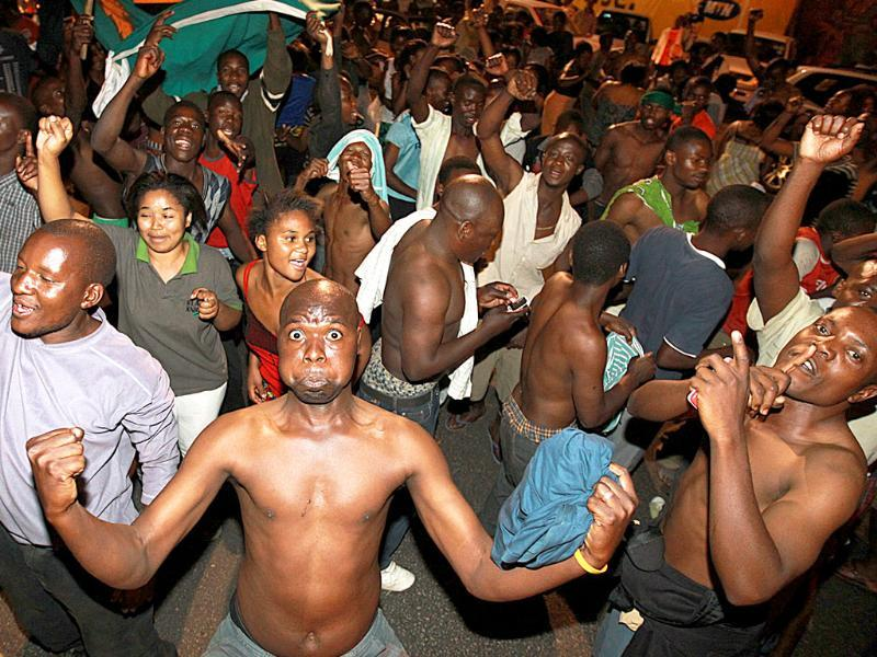 People celebrate in Lusaka early, after Opposition Leader Michal Sata was declared winner of Zambia's President election by the Chief Justice Ernest Sakala.