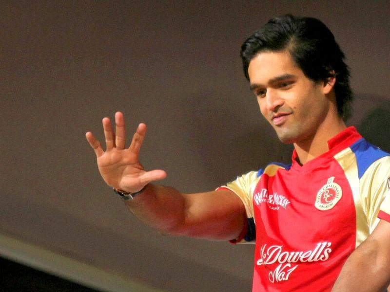 RCB owner Sidharth Mallya waves during the Champions league T20 match in Bangalore.