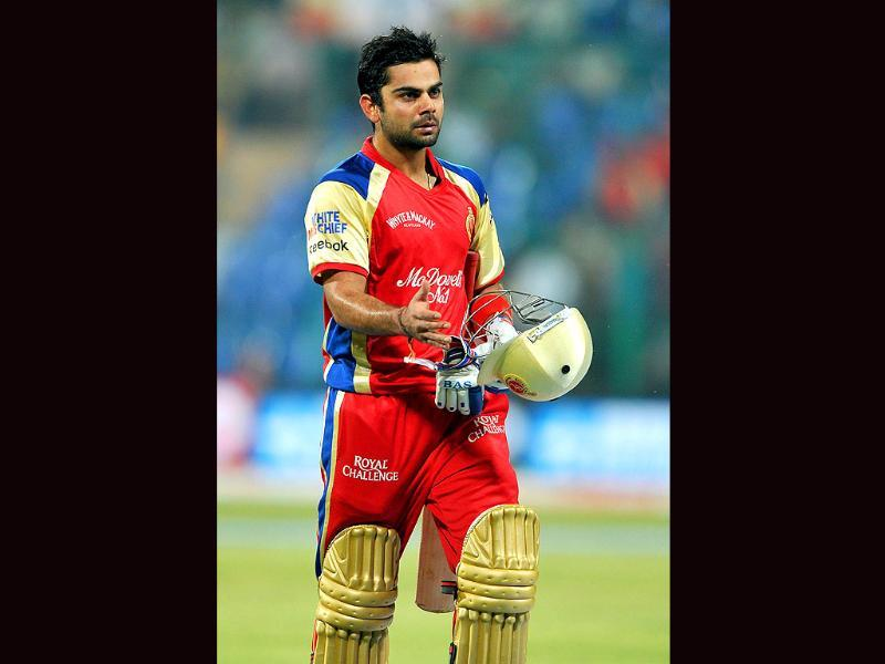 RCB's Virat Kholi walks off the field after being dismissed by the Warriors during the Champions League Cricket Twenty20 League group B match.