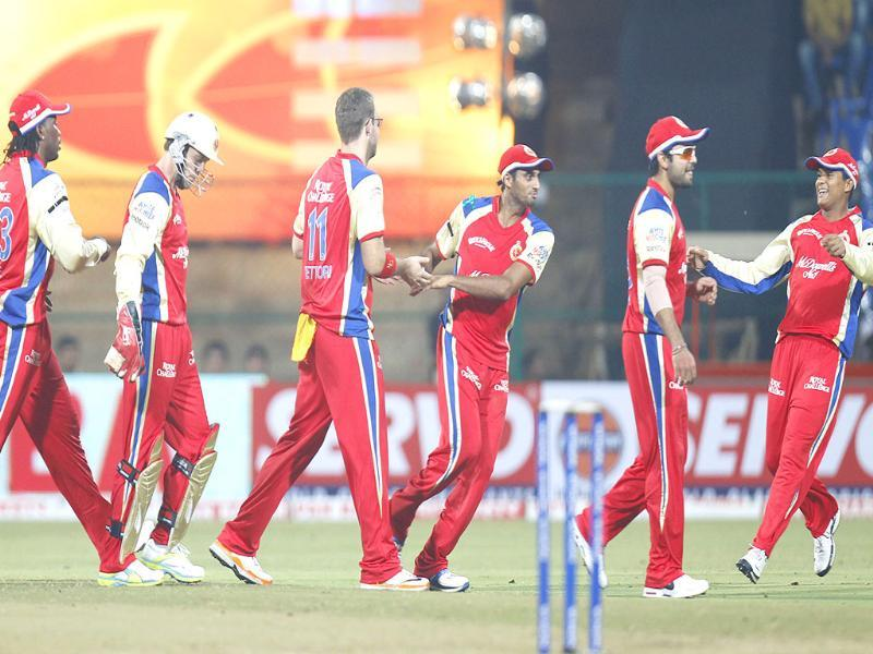 RCB bowler celebrates with teammates the wicket of Warriors batsman during the CLT20 match in Bangalore.