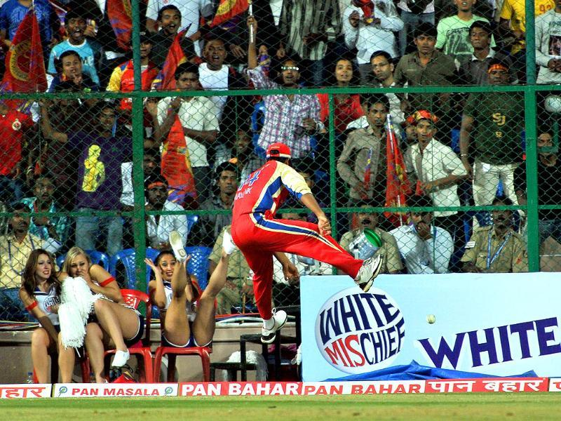 RCB fielder Mayank Agarwal jumps in an attempt to stop a sixer during the Champions League Twenty20 League group B match between Royal Challengers Bangalore and Warriors at the M Chinnaswamy Stadium in Bangalore.