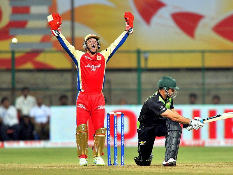 Mark Boucher (R) is dismissed by LBW as RCB wicket keeper AB De Villiers appeals to the umpire during the Champions League Twenty20 League group B match.