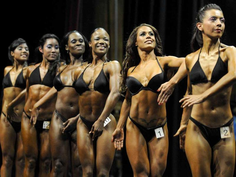 Participants compete in the women's category at the 39th Central American and the Caribbean Bodybuilding championships in San Salvador.