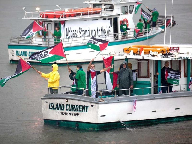 Members of Avaaz, a global campaign organisation, take to the East River in boats to demonstrate for Palestinian statehood outside the UN headquarters in the Manhattan borough of New York.