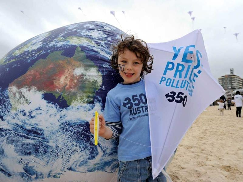 Harrison Adamsy prepares to fly his 'YES! Price Pollution' kite at the launch of 350.Org's Moving Planet Day on Sydney's Bondi Beach.