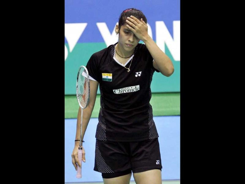 Saina Nehwal reacts during the semifinal of the Japan Open Badminton Tournament against Juliane Schenk of Germany in Tokyo.