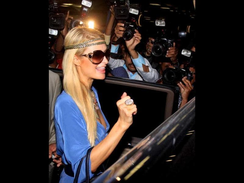 American businesswoman, socialite, model and fashion designer Paris Hilton arrives at the Mumbai International Airport.