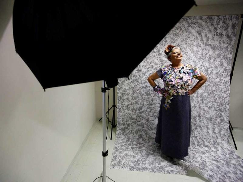 Cancer patient Aparecida Bocaloni poses for a photographer backstage before her Festival of the Life fashion show at the Cancer Perola Byington Hospital in Sao Paulo.