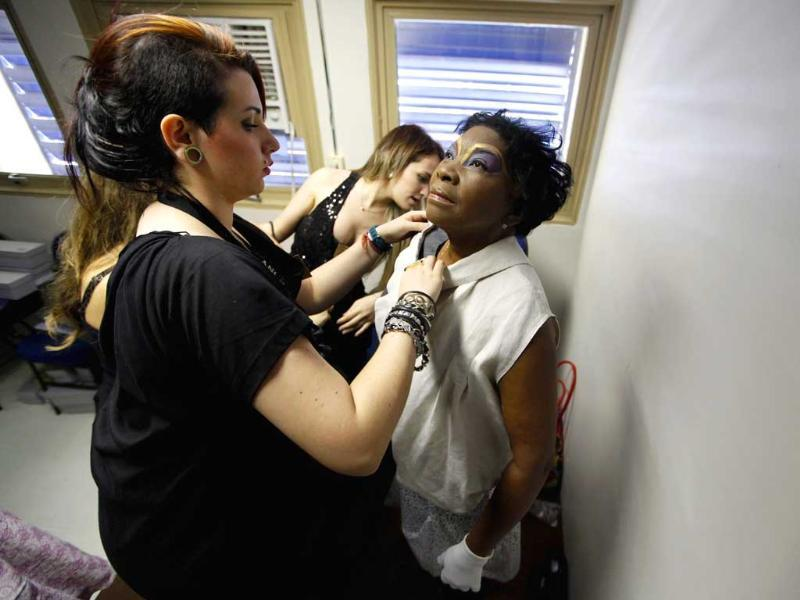 Stylists prepare cancer patient Maria de Souza (C) backstage for the Festival of the Life fashion show at the Cancer Perola Byington Hospital in Sao Paulo.