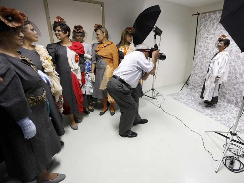 Cancer patient Nilsa Salles (R) poses for a photographer in front of her friends before the Festival of the Life fashion show at the Cancer Perola Byington Hospital in Sao Paulo.