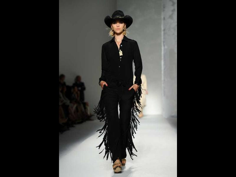 Cowgirl! A model walks the ramp in black frayed pants and cowboy hat at Milan fashion week.