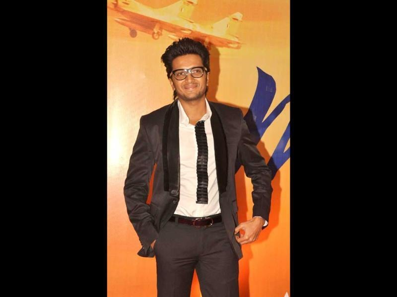 Riteish Deshmukh looks cheerful as he poses for lensmen. (AFP)