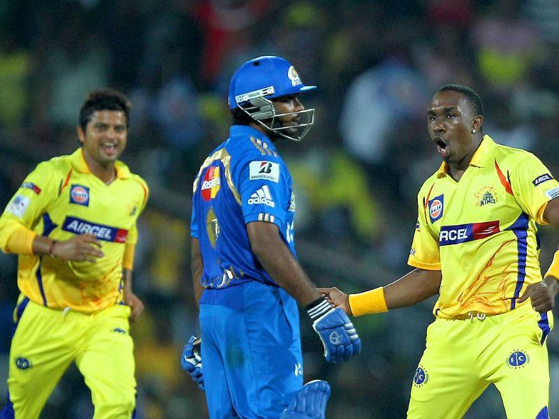 Chennai Super Kings' players celebrating the wicket of Ambati Rayudu during the Champions league T20 match at MAC Stadium in Chennai.