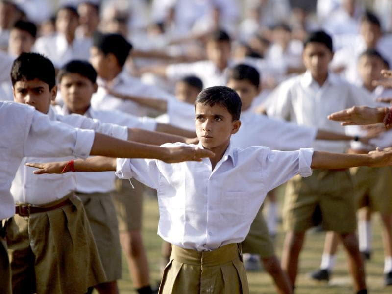 Volunteers of Rashtriya Swayamsevak Sangh (RSS) perform yoga during a public meeting in Jammu.