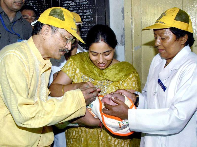 Uttarakhand chief minister BC Khanduri administering polio drops to a child during Pulse Polio Day in Dehradun.
